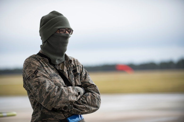 A crew chief watches as fellow maintainers preform a thru flight inspection on an A-10C Thunderbolt II, Dec. 7, 2017, at Moody Air Force Base, Ga. Moody recently participated in a week-long, Phase 1, Phase 2 exercise designed to demonstrate the 23d Wing's ability to meet combatant commander objectives. The exercise tested pilots' and maintainers' ability to launch around-the-clock sorties at an accelerated rate during surge operations. (U.S. Air Force photo by Andrea Jenkins)