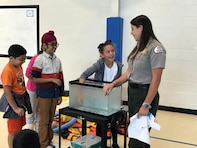 Lake Sidney Lanier Park Ranger Rachel Rush teaches fourth graders the importance of water safety and the beauty of our national parks during a visit to a local school earlier this year. Rush was recently recognized for her efforts to promote the Every Kid in a Park initiative by the U.S. Army Corps of Engineers, South Atlantic Division.