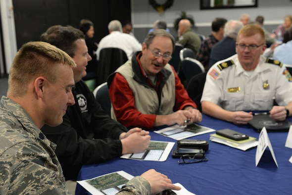 Base leaders and community partners discuss possible initiatives Dec. 12, 2017, on Columbus Air Force Base, Mississippi, during an Air Force Community Partnership meeting. These gatherings help develop new and better ways to benefit the Air Force and the surrounding communities through emergency management, Airmen Against Drunk Driving, downtown shooting range use and more. (U.S. Air Force photo by Airman 1st Class Keith Holcomb)
