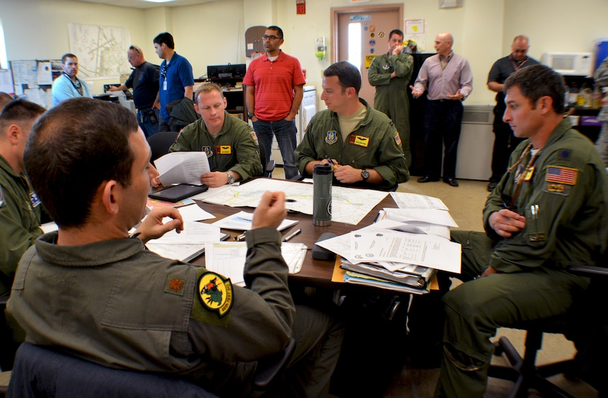 A 507th Air Refueling Wing KC-135R Stratotanker aircrew from Tinker Air Force Base, Okla., discusses the day's flight plan with engineers from the Large Aircraft Infrared Countermeasures system project team at Eglin AFB, Fla., Nov. 28, 2017. The flight plan was designed to test the aircraft's LAIRCM modification in a path over mundane terrain to assist in the elimination of false system responses. (U.S. Air Force photo/Tech. Sgt. Samantha Mathison)