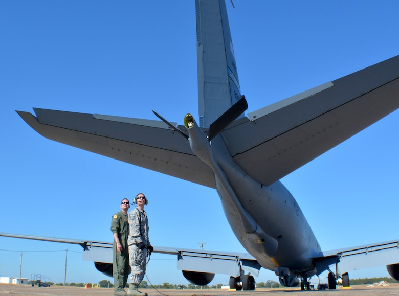 507th Aircraft Maintenance Squadron Tech. Sgts. Michael Dunning, crew chief, and Eric Harmon, avionics technician, from Tinker Air Force Base, Okla., observe flight operations while preparing a KC-135R Stratotanker for flight at Eglin AFB, Fla., Nov. 28, 2017. 507th Air Refueling Wing Reserve Citizen Airmen from Tinker AFB flew the KC-135R to Eglin AFB for testing of the Large Aircraft Infrared Countermeasures modification recently installed on the aircraft. (U.S. Air Force photo/Tech. Sgt. Samantha Mathison)