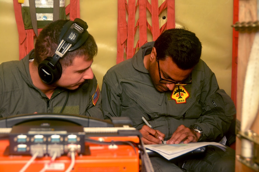 James Broches (left) and Swapnil Christian (right), Northrop Grumman flight test engineers at Eglin Air Force Base, Fla., monitor Large Aircraft Infrared Countermeasures system test equipment while in flight on a 507th Air Refueling Wing KC-135R Stratotanker from Tinker AFB, Okla., Nov. 29, 2017. Reserve Citizen Airmen flew the aircraft more than 60 times over a test range at Eglin AFB while a laser simulated incoming missiles for the LAIRCM system to detect and deflect. (U.S. Air Force photo/Tech. Sgt. Samantha Mathison)