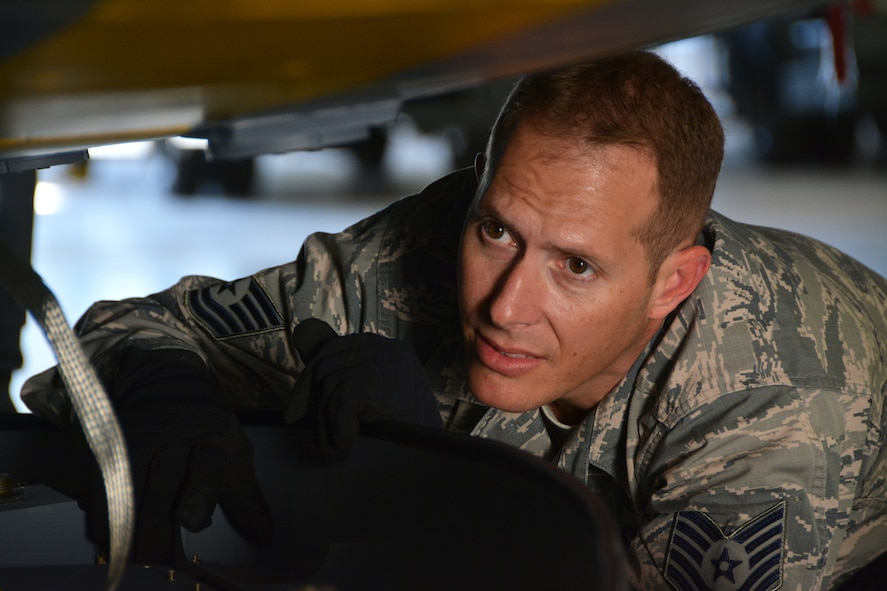 Tech. Sgt. Eric Harmon, 507th Aircraft Maintenance Squadron avionics technician, inspects the area of the KC-135 where the Large Aircraft Infrared Countermeasures pod attaches to the underside of the aircraft Oct. 25, 2017, at Tinker Air Force Base, Okla. (U.S. Air Force photo/Tech. Sgt. Samantha Mathison)