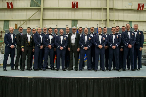 U.S. Air Force Test Pilot School Class 17A pose for a group photo on the graduation stage in Hangar 1623 Dec. 8. (U.S. Air Force photo by Ethan Wagner)