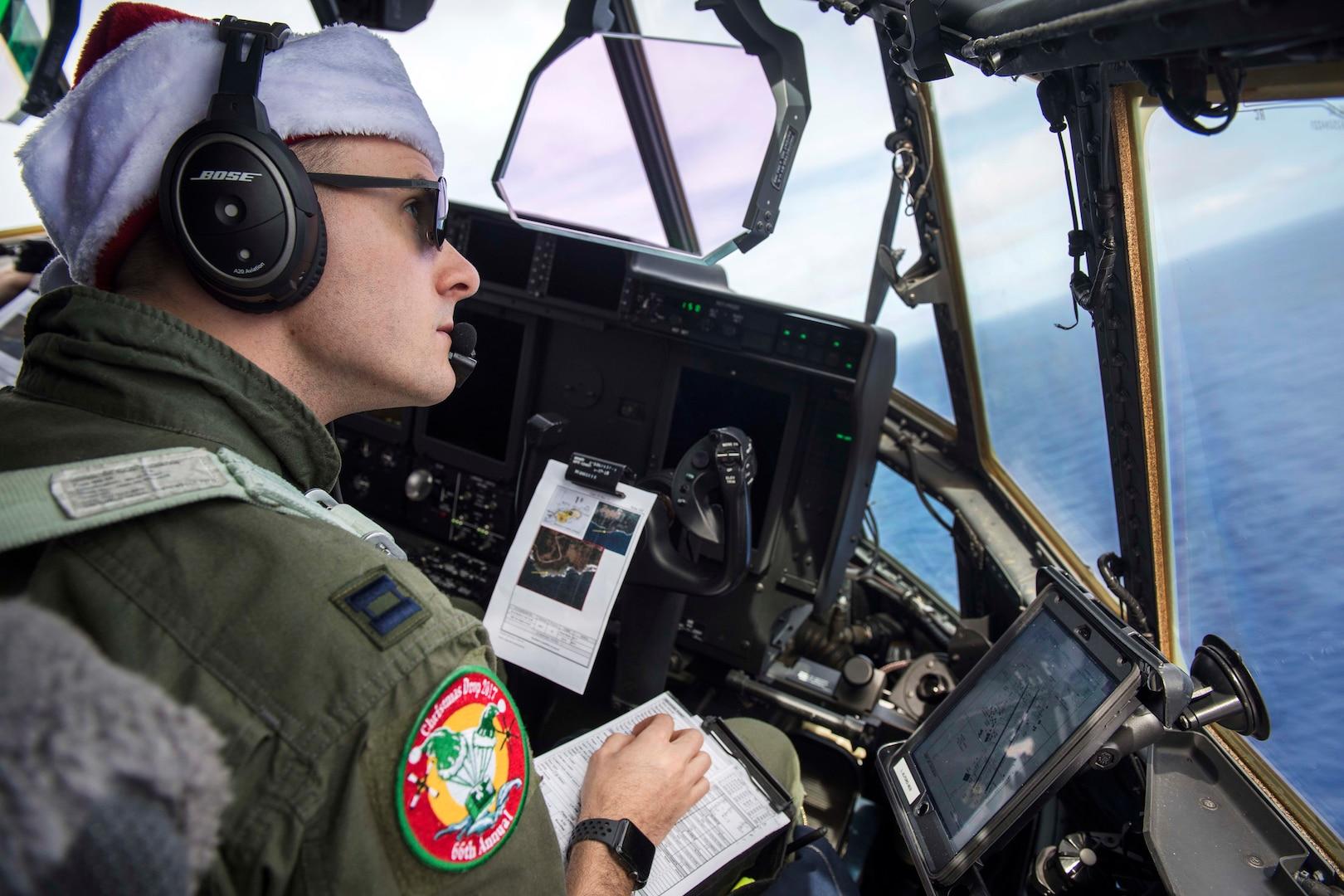 Air Force Capt. Lionel Alford flies a C-130J Super Hercules over Andersen Air Force Base.