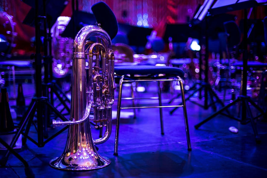 A tuba rests among United States Air Forces in Europe Band equipment on stage at Fruchthalle in Kaiserslautern, Germany, Dec. 8, 2017. Since 1943, the USAFE Band has fostered the tradition of performing live music for official military functions and community outreach events throughout the continents of Europe and Africa. (U.S. Air Force photo by Senior Airman Devin Boyer)