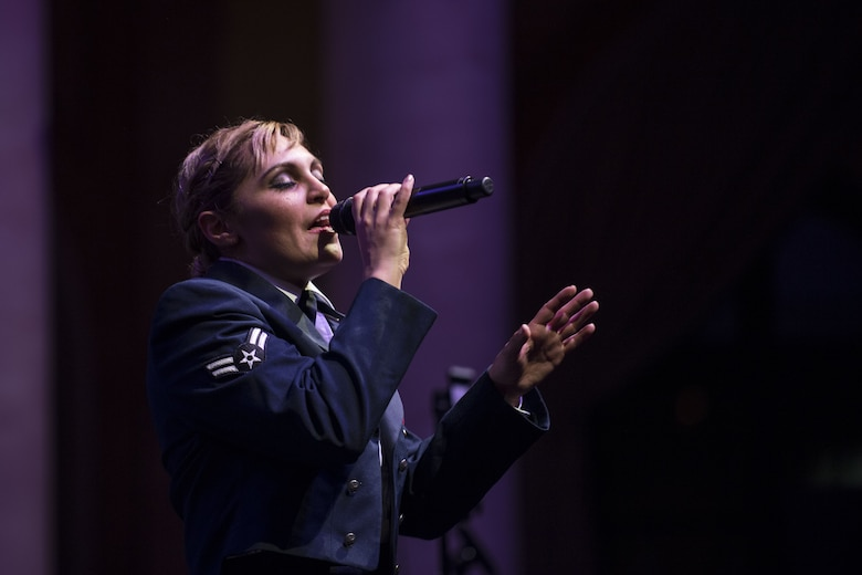 U.S. Air Force Airman 1st Class Linda Casul, United States Air Forces in Europe Band singer, performs during a Christmas concert at Fruchthalle in Kaiserslautern, Germany, Dec. 8, 2017. The USAFE Band is comprised of 45 active duty Air Force musicians, committed to fortifying international relationships, enhancing troop morale and fostering trust and friendship between the United States and the diverse populations across the European and African continents. (U.S. Air Force photo by Senior Airman Devin Boyer)