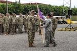U.S. Air Force Maj. Nicole Schatz (right), Joint Security Forces commander, passes the unit colors to U.S. Army National Guard 1st Sgt. Eliezer Castrodad (left), incoming JSF senior enlisted advisor, during a change of responsibility ceremony held at Soto Cano Air Base, Honduras, Dec. 11, 2017. Castrodad reported from the 755th Military Police Company, Puerto Rico National Guard. He proudly served in Operation Enduring Freedom and some of his most important military awards include the Army Achievement medal, Army Global Conduct Medal and Army National Defense Medal. (U.S. Army photo by Maria Pinel)