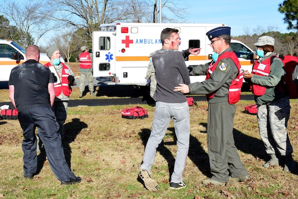 Members of the 4th Medical Group respond to exercise participants with simulated injuries during a mass casualty exercise Dec. 13, 2017, at Seymour Johnson Air Force Base, North Carolina.