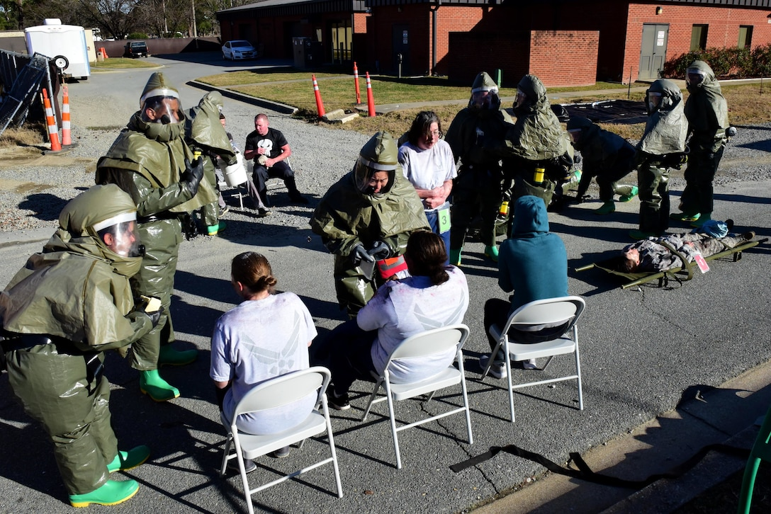 Members of the 4th Medical Group decontamination team treat patients covered with simulated biohazard material during a chemical, biological, radiological, nuclear and explosive mass casualty exercise Dec. 13, 2017, at Seymour Johnson Air Force Base, North Carolina.