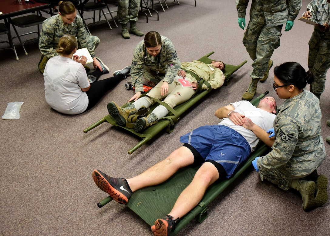 Members of the 4th Medical Group clinical team treat patients with simulated injuries during a mass casualty exercise Dec. 13, 2017, at Seymour Johnson Air Force Base, North Carolina.