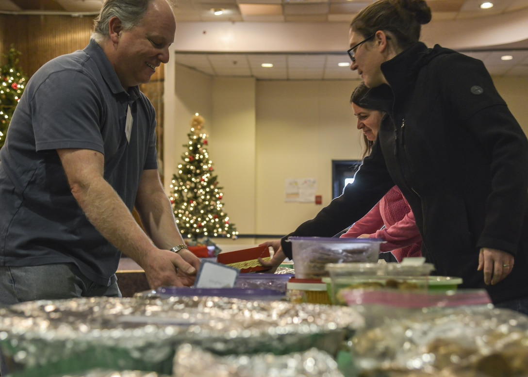 Members of the Kirtland Spouses Club organize and bag cookies during the Kirtland Spouse's cookie drive at Kirtland Air Force Base, N.M., Dec. 12. More than 65 bakers contributed to the drive, bringing in around 4,700 cookies.
