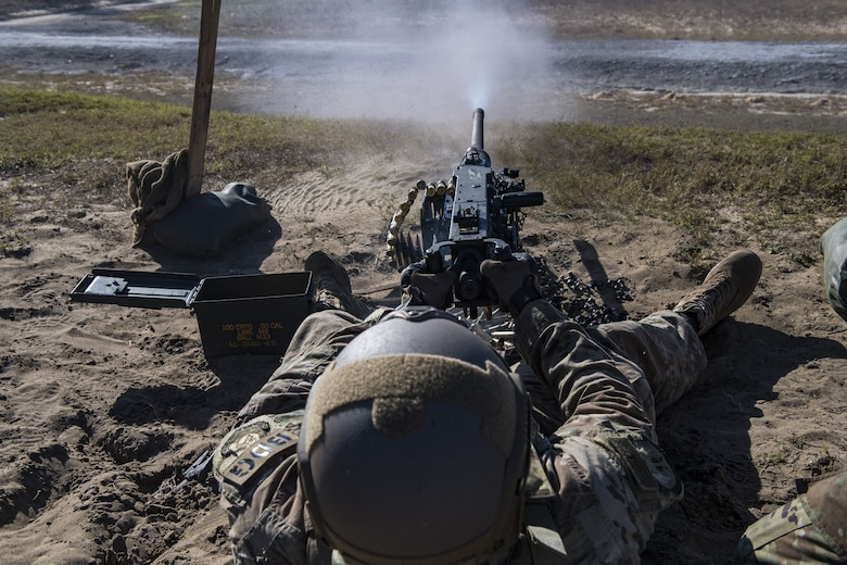 Staff Sgt. Richard Murkin, 823d Base Defense Squadron fireteam member, fires a .50 Caliber M2 machine gun, during a heavy weapons qualification, Dec. 13, 2017, at Camp Blanding Joint Training Center, Fla. Airmen shot at targets with the M2 to maintain their proficiency and familiarize themselves with the weapon. (U.S. Air Force photo by Senior Airman Janiqua P. Robinson)