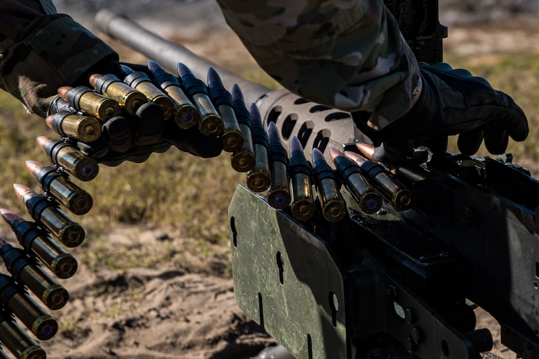 An Airman from the 823d Base Defense Squadron, loads a .50 Caliber M2 machine gun during a heavy weapons qualification, Dec. 13, 2017, at Camp Blanding Joint Training Center, Fla. Airmen shot at targets with the M2 to maintain their proficiency and familiarize themselves with the weapon. (U.S. Air Force photo by Senior Airman Janiqua P. Robinson)