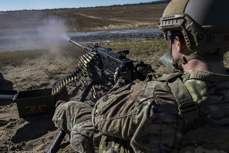 Staff Sgt. Richard Murkin, 823d Base Defense Squadron fireteam member, fires a .50 Caliber M2 machine gun during a heavy weapons qualification, Dec. 13, 2017, at Camp Blanding Joint Training Center, Fla. Airmen shot at targets with the M2 to maintain their proficiency and familiarize themselves with the weapon. (U.S. Air Force photo by Senior Airman Janiqua P. Robinson)