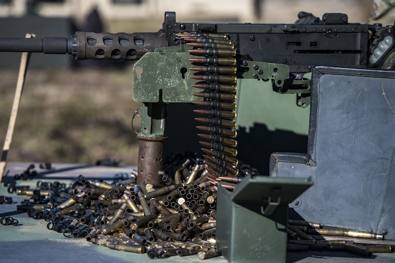 An Airman from the 823d Base Defense Squadron, readies a .50 Caliber M2 machine gun during a heavy weapons qualification, Dec. 13, 2017, at Camp Blanding Joint Training Center, Fla. Airmen shot at targets with the M2 to maintain their proficiency and familiarize themselves with the weapon. (U.S. Air Force photo by Senior Airman Janiqua P. Robinson)