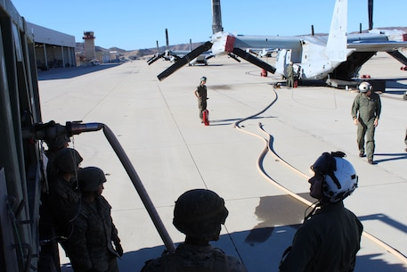 9th Communication Battalion Marines receive training on air to ground refueling from VMM-164 during the Battalion Field Training Exercise 1-18.