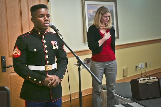 Cpl.  Marlonzo  Bowier  sings  the  national  anthem  during  the  48th  annual  Senior  Tea  aboard  Marine  Corps  Air  Station  Beaufort,  Dec.  10.  Bowier  volunteered  his  time  to  preform two songs at the opening and closing of the entertainment time of the senior tea. Bowier is a bulk fuels specialist with Headquarters and Headquarters Squadron.