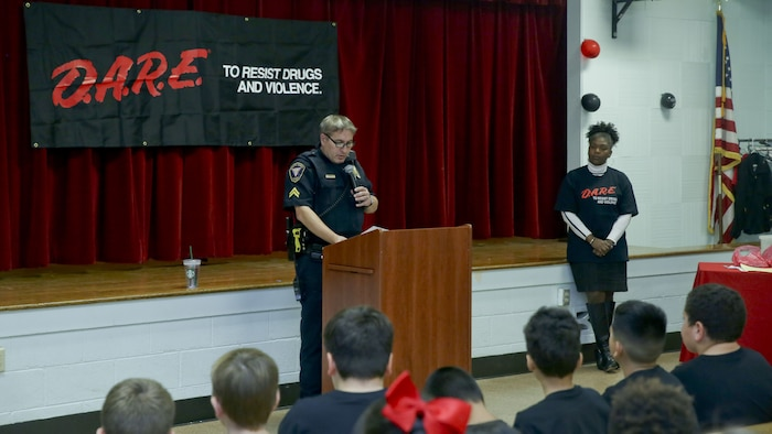Cpl. Chris Stephens speaks to students at the graduation of the Drug Abuse Resistance Education program at Laurel Bay, Dec. 8. The goal of the program is the educate students on the danger of substance abuse. Stephens is the school resource officer for Laurel Bay schools.