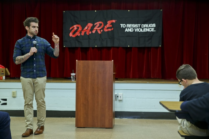 Jason Clark speaks to students at the graduation of the Drug Abuse Resistance Education program at Laurel Bay, Dec. 8. The goal of the program is the educate students on the danger of substance abuse. Clark was the guest speaker at the graduation.