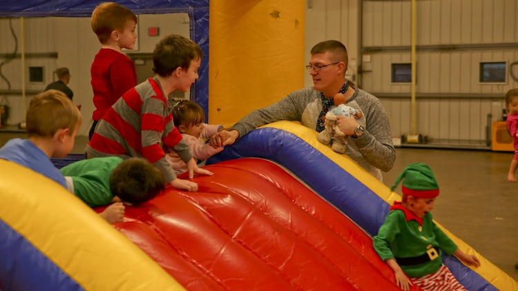 Children play in a bounce house at the Headquarters and Headquarters Squadron Christmas party aboard Marine Corps Recruit Depot Parris Island, Dec. 9. The party was held to foster unit cohesion and celebrate the upcoming holiday season.