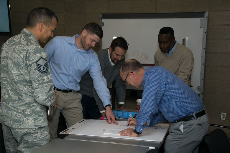 Students from the multiple agencies involved in the Aviation Domain Awareness Training Course brainstorm during an exercise at Goodfellow Air Force Base, Texas, Dec. 8, 2017. The week long course taught individuals from multiple agencies about the various threats and security systems in place to prevent any type of aviation threat that may arise in the future. (U.S. Air Force photo by David Lynch /Released)