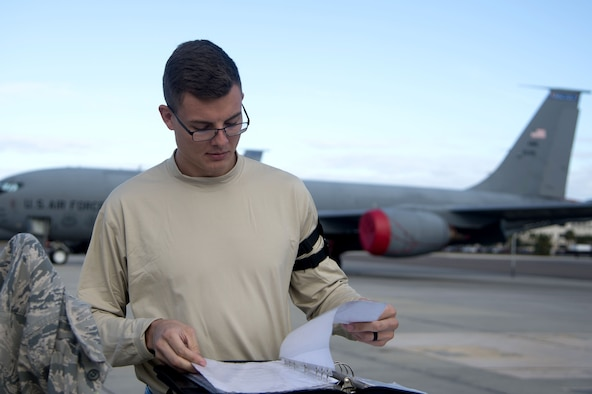 U.S Air Force Senior Airman Austin Holbert, a crew chief assigned to the 6th Aircraft Maintenance Squadron, looks over paperwork before inspecting a KC-135 Stratotanker aircraft at MacDill Air Force Base, Fla., Dec. 14, 2017.