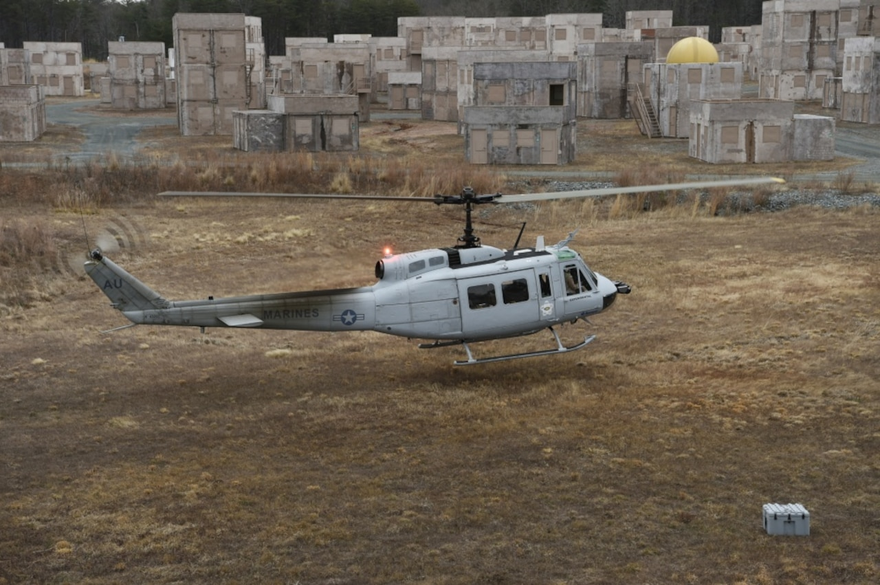 A UH-1 Huey helicopter equipped with an Office of Naval Research-sponsored Autonomous Aerial Cargo/Utility System autonomy kit makes an approach for landing during final testing at Marine Corps Base Quantico, Va.