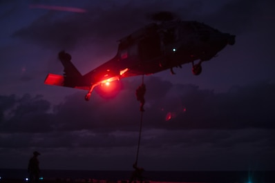 Marines with Force Reconnaissance Platoon, Maritime Raid Force, 31st Marine Expeditionary Unit, rappel from a Navy MH-60S Seahawk helicopter during helicopter rope suspension training aboard the USS Bonhomme Richard (LHD 6) while underway in the Pacific Ocean, June 25, 2017. The FRP Marines train regularly for quick, tactical raids of targets on both land and sea. Fast roping allows Marines to enter otherwise inaccessible locations via rope from a hovering aircraft. The 31st MEU partners with the Navy's Amphibious Squadron 11 to form the amphibious component of the Bonhomme Richard Expeditionary Strike Group. The 31st MEU and PHIBRON 11 combine to provide a cohesive blue-green team capable of accomplishing a variety of missions across the Indo-Asia-Pacific region. (Official U.S. Marine Corps photo by Lance Cpl. Stormy Mendez/Released)