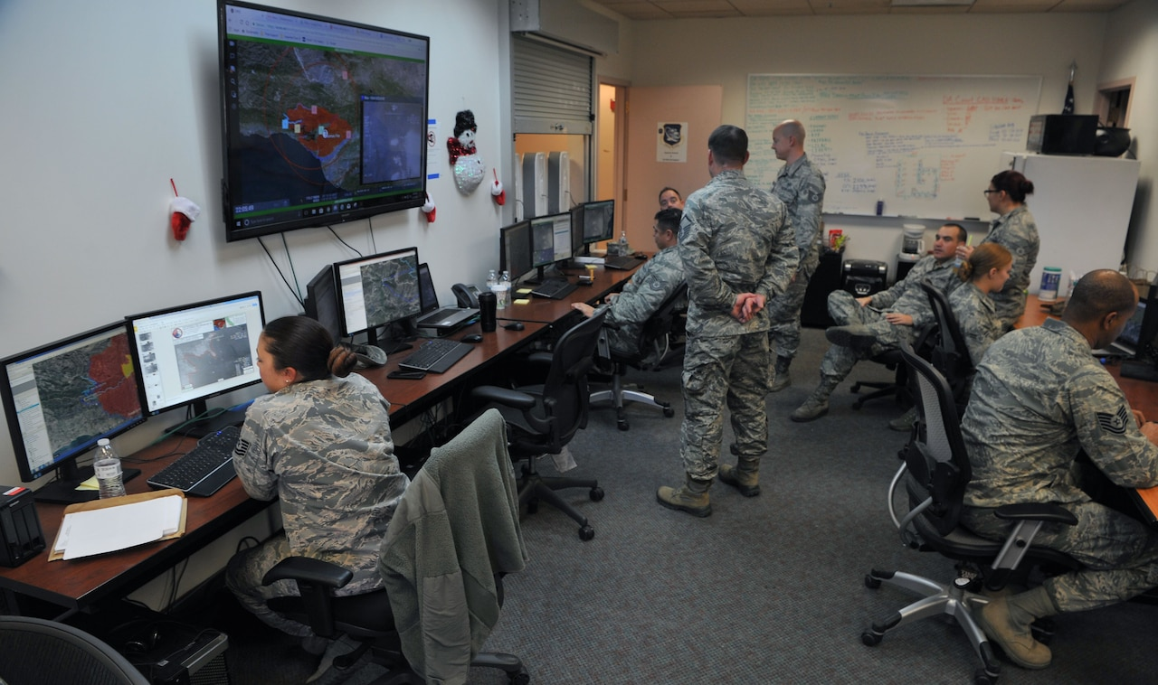 Air National Guard members from the 195th Intelligence, Surveillance, and Reconnaissance Group analyze full-motion video of the Thomas Fire and relay their findings to fire crews on the ground