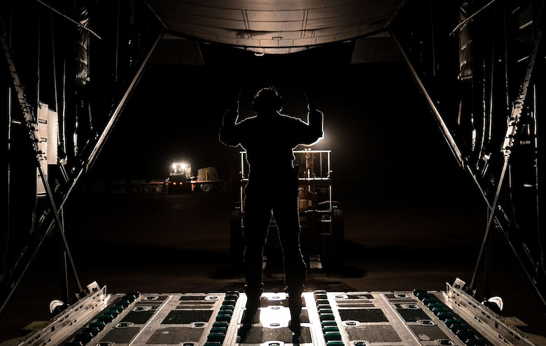 Airman 1st Class Courtney Wagner, 774th Expeditionary Airlift Squadron loadmaster, marshals a forklift onto a C-130J Super Hercules Dec. 9, 2017 at Bagram Airfield, Afghanistan.