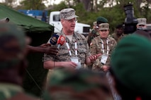 Maj. Gen. Mark E. Bartman, Ohio adjutant general, talks to the Angolan press in the village of Vale do Paraiso during the PAMBALA medical exercise Dec. 9, 2017, in Bengo, Angola. PAMBALA, the first-ever trilateral combined medical engagement to take place in the Republic of Angola, is an agreement between the Angolan Armed Forces, Serbian Armed Forces and the Ohio National Guard to share best practices, strengthen medical treatment processes, establish new relationships and nurture established partnerships. (Ohio National Guard photo by Staff Sgt. Wendy Kuhn)