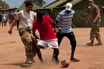 Members of the Ohio National Guard play soccer with children in the village of Vale do Paraiso during the PAMBALA 2017 medical exercise Dec. 12, 2017, in Bengo Province, Angola. The purpose of the engagement for the Ohio National Guard is to give personnel the opportunity to share best practices, strengthen medical treatment processes, establish new relationships with members of the Angolan Armed Forces and to nurture their existing 11-year partnership with Serbia, through the National Guard State Partnership Program. (Ohio National Guard photo by Staff Sgt. Wendy Kuhn)