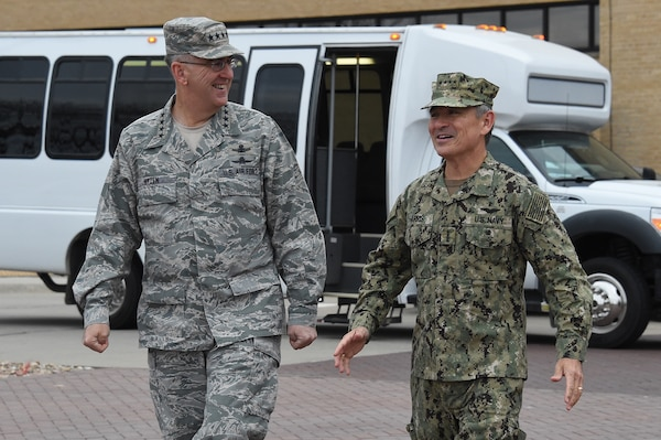 U.S. Navy Adm. Harry Harris, commander of U.S. Pacific Command (USPACOM), speaks with U.S. Air Force Gen. John Hyten, commander of U.S. Strategic Command (USSTRATCOM), on the USSTRATCOM missile deck during his visit to Offutt Air Force Base, Neb., Dec. 14, 2017. Harris met with Hyten and other senior leaders for discussions on USSTRATCOM operations as they pertain to the USPACOM area of responsibility. They also discussed collaboration and integration between combatant commands during exercise and real-world scenarios. Engagements like these support USSTRATCOM's efforts to maintain close relationships with other combatant commands to deter adversaries and assure allies. Maintaining a combat-ready force, one of Hyten's three priorities, and training exercises like the upcoming Global Lightning are crucial to ensuring USSTRATCOM and its components are prepared to deliver a decisive response should they be called upon to do so. These efforts support USSTRATCOM's top priority; to provide strategic deterrence using tailored nuclear, cyber, space, global strike, joint electronic warfare, missile defense, and intelligence capabilities.