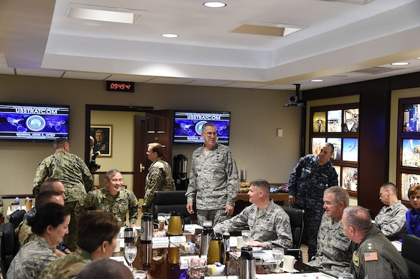 U.S. Navy Adm. Harry Harris (seated, center left), commander of U.S. Pacific Command (USPACOM), speaks with U.S. Air Force Gen. John Hyten (standing, center), commander of U.S. Strategic Command (USSTRATCOM), and other command leaders before a mission brief at Offutt Air Force Base, Neb., Dec. 14, 2017. Harris met with Hyten and other senior leaders for discussions on USSTRATCOM operations as they pertain to the USPACOM area of responsibility. They also discussed collaboration and integration between combatant commands during exercise and real-world scenarios. Engagements like these support USSTRATCOM's efforts to maintain close relationships with other combatant commands to deter adversaries and assure allies. Maintaining a combat-ready force, one of Hyten's three priorities, and training exercises like the upcoming Global Lightning are crucial to ensuring USSTRATCOM and its components are prepared to deliver a decisive response should they be called upon to do so. These efforts support USSTRATCOM's top priority; to provide strategic deterrence using tailored nuclear, cyber, space, global strike, joint electronic warfare, missile defense, and intelligence capabilities.