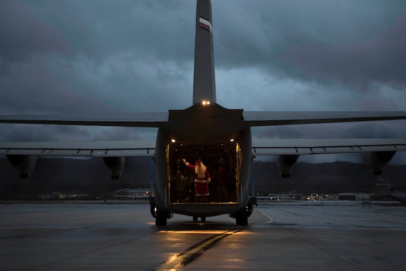 Santa Claus arrives at the Rudolph the Red Nosed Herc event, in a U.S. Air Force C-130J Super Hercules, on Ramstein Air Base, Germany, Dec. 14, 2017. Santa posed for photos with children of servicemembers from the 86th Airlift Wing. (U.S. Air Force photo by Senior Airman Devin M. Rumbaugh)