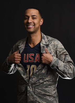 Technical Sgt. Corey Rucker, 20th Air Force facility maintenance section lead, poses in his team USA basketball jersey at F.E. Warren Air Force Base, Wyo., Dec. 14, 2017. Rucker played for the 2017 U.S. Armed Forces Men's Basketball Team and won gold at the SHAPE International Basketball Tournament in Europe.