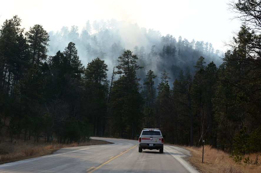 The park wildfire grew rapidly overnight, pushing beyond the park's borders and threatening nearby communities.