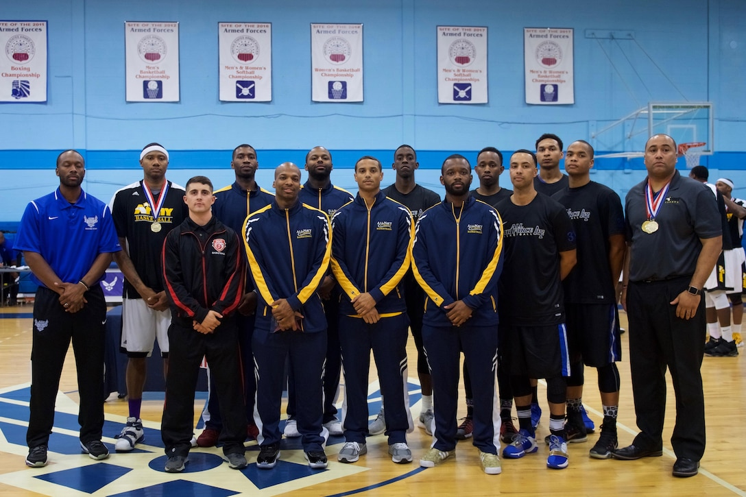 Tech. Sgt. Corey Rucker poses with fellow members of the U.S. Armed Forces Men's Basketball Team at Lackland Air Force Base, Texas, Nov. 7, 2107. The team won gold at the SHAPE International Basketball Tournament in Europe.
