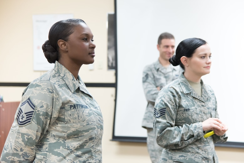 "Senior Master Sgt. Tiffany Patterson, Keesler career assistance advisor, and Staff Sgt. Debbie Fair, professional development noncomissioned officer in charge, lead a group of Airmen in an activitiy called ""find the common thread"" during a First Term Airman's Course Dec. 11, 2017 at Keesler Air Force Base, Mississippi. (U.S. Air Force photo by Staff Sgt. Heather Heiney)"