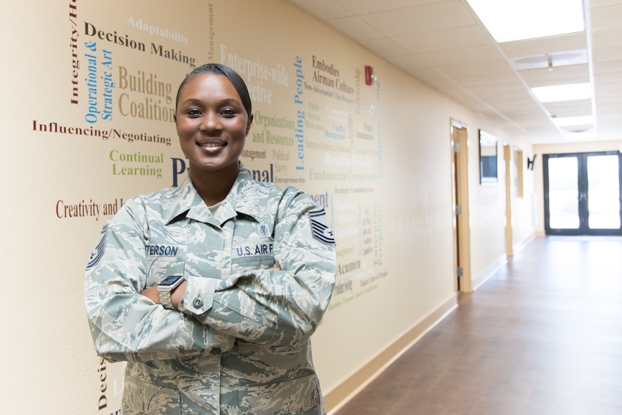 Senior Master Sgt. Tiffanny Patterson, Keesler career assistance advisor, poses for a photo at Keesler Air Force Base, Mississippi's recently rennovated Professional Development Center. Patterson is charged with facilitating professional development opportunities for reserve, active duty and civilian members of the base. (U.S. Air Force photo by Staff Sgt. Heather Heiney)