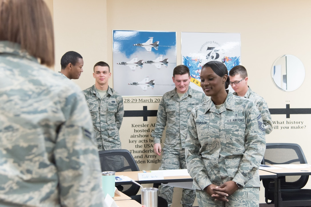 "Senior Master Sgt. Tiffany Patterson, Keesler career assistance advisor, leads a group of Airmen in an activitiy called ""find the common thread"" during a First Term Airman's Course Dec. 11, 2017 at Keesler Air Force Base, Mississippi. (U.S. Air Force photo by Staff Sgt. Heather Heiney)"