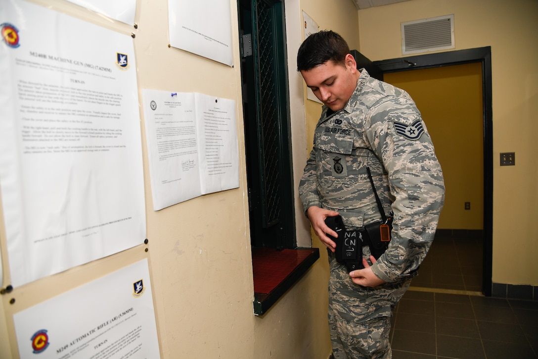 Staff Sgt. Matthew Pick, 66th Security Forces Squadron, equips himself with one of five opioid overdose medications.