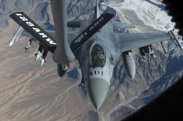 An F-16 Fighting Falcon, assigned to the 77th Expeditionary Fighter Squadron, prepares to be refueled by a KC-135 Stratotanker, over the skies of Afghanistan Nov. 19, 2017. F-16s are used to provide vital air support to Afghan and coalition forces on the ground. (U.S. Air Force photo by Staff Sgt. Sean Martin)