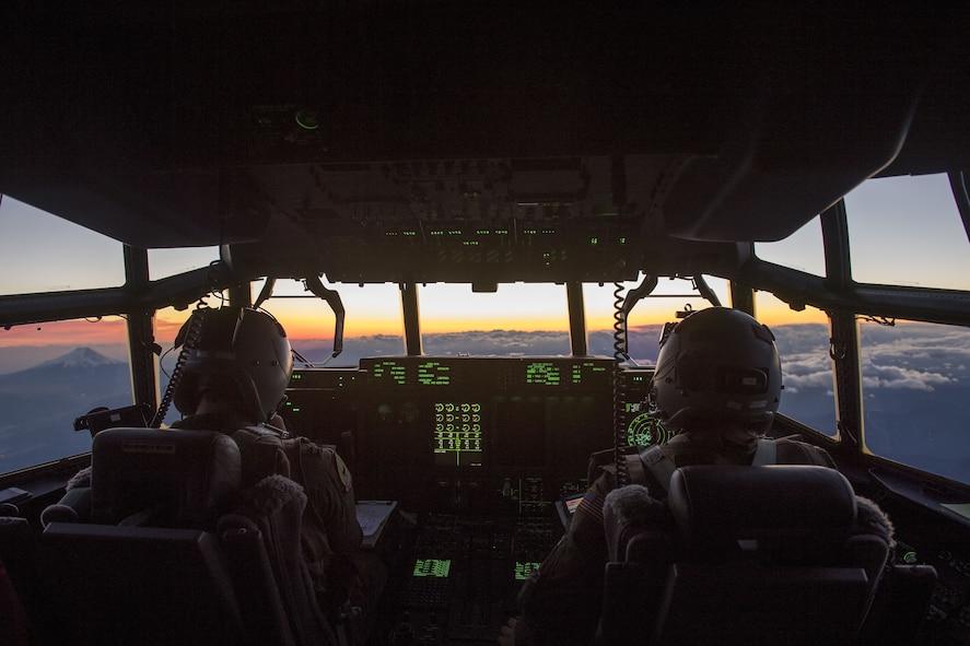 A C-130J Super Hercules from Little Rock Air Force Base, Ark., flies past Mt. Fuji during exercise Vigilant Ace 18, Dec. 6, 2017, over the Saitama prefecture, Japan. (U.S. Air Force photo by Senior Airman Donald Hudson)