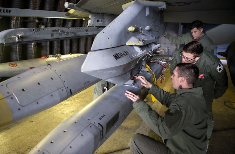F-16 pilots assigned to the 480th Fighter Squadron inspect weapons during a week-long verification event, Dec. 1, 2017 at Spangdahlem Air Base, Germany. Verification is the final mission qualification training required for designation as a combat mission-ready pilot. Seven pilots earned CMR certification and capability during the event. (U.S. Air Force photo by Senior Airman Preston Cherry)