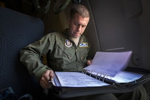 Staff Sgt. Andrew E. Nanni, 714th Aircraft Maintenance Squadron, 514th Air Mobility Wing, reviews maintenance paperwork prior to takeoff at Joint Base Pearl Harbor-Hickam, Hawaii, Dec. 9, 2017. The 514th AMW is an Air Force Reserve Command wing located at Joint Base McGuire-Dix-Lakehurst, N.J. (U.S. Air Force photo by Master Sgt. Mark C. Olsen)