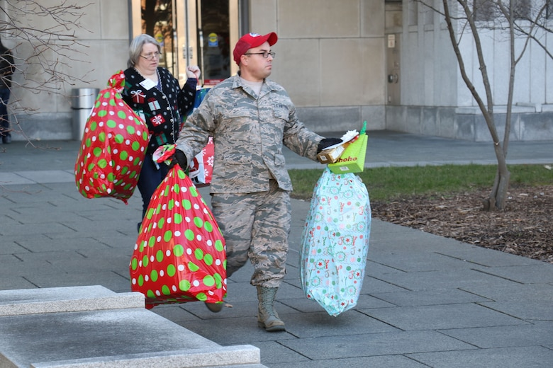 As part of the 28th annual Holiday Wish Program, Tech. Sgt Kevin Foy, 201st RED HORSE Squadron, along with other Pennsylvania Guardsmen and with the help of volunteer state employees, load donated gifts into military vehicles at the Keystone Building, Harrisburg, Pennsylvania, Dec. 6, 2017. The donated gifts were delivered to participating county assistance offices for distribution to families and individuals.  (U.S. Air National Guard photo by Master Sgt. Culeen Shaffer/Released)