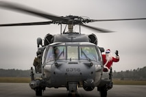 Santa poses with the crew of an HH-60G Pave Hawk from the 41st Rescue Squadron, Dec. 9, 2017, on the flightline at Moody Air Force Base, Ga. Every year Santa makes his grand entrance by helicopter to attend the 23rd Maintenance Group and 347th Rescue Group holiday party, where he poses for photos with children and listens to Christmas wish lists. (U.S. Air Force photo by Staff Sgt. Ryan Callaghan)