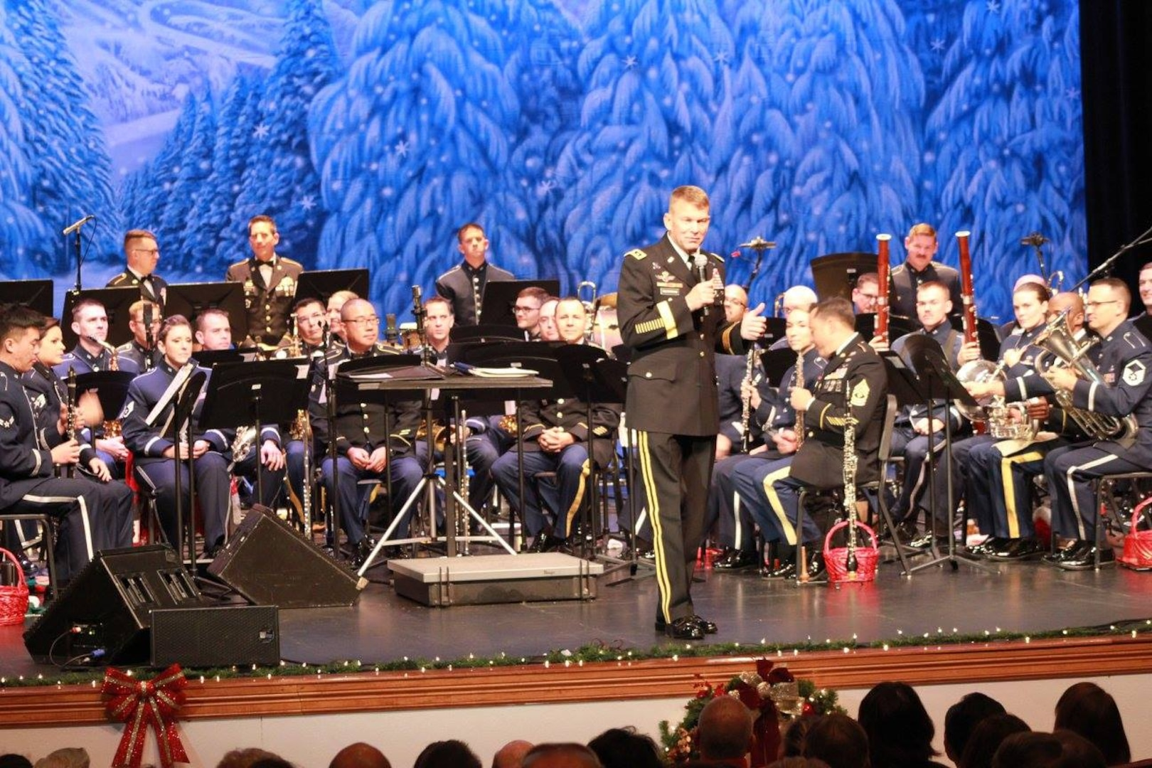 """Lt. Gen. Jeffrey Buchanan, U.S. Army North commanding general, introduces the U.S. Air Force Band of the West and the 323rd Army Band """"Fort Sam's Own"""" as they team up for a """"Holiday in Red, White and Blue"""" concert Dec. 9, 2017 at the Edgewood Performing Arts Center, 402 Lance St., in San Antonio. The annual performance is free and open to the public and is a holiday tradition."""
